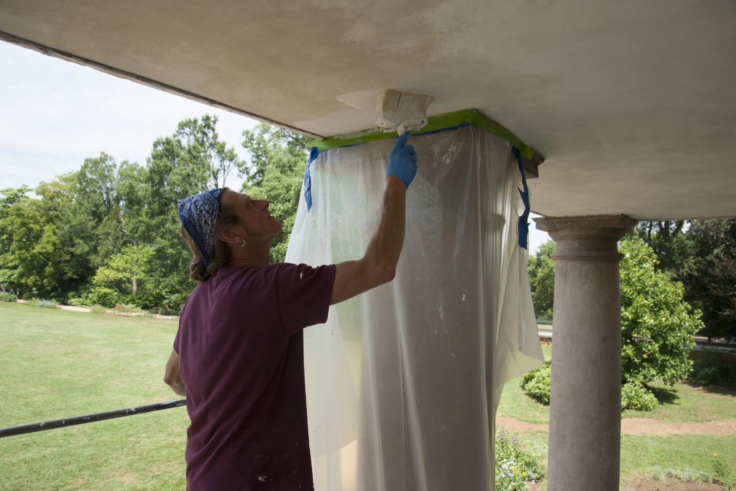 Restoration Specialist Jolen Bain applying a traditional limewash to the restored West Portico ceiling